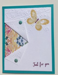 A side fold with lovely paper underneath . Isn't it pretty with the embossing and the butterfly stamp.